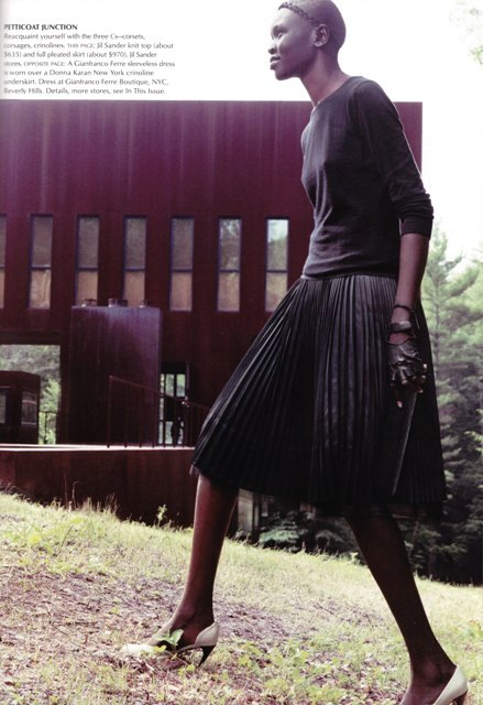 black tshirt and pleated skirt