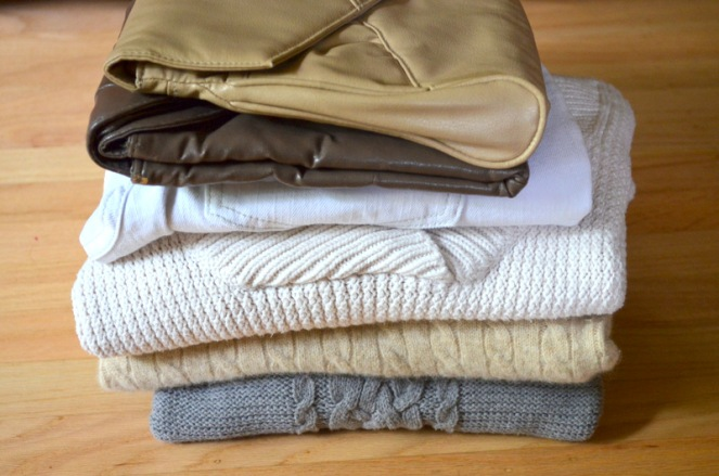 neutral sweaters and clutches