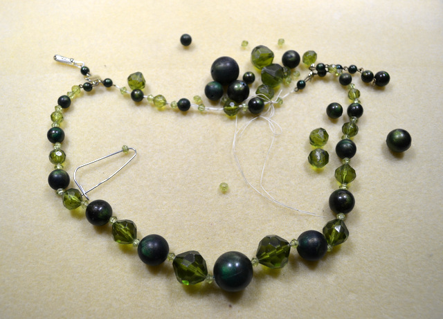 broken green necklace