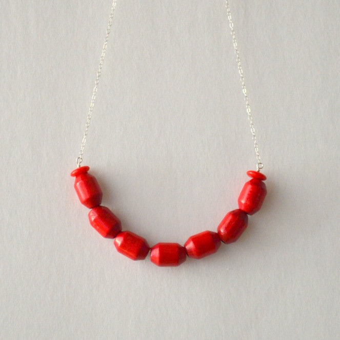 red wooden bead necklace